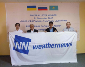 Satellite project staff in Russia with Weathernews RMD Captain Jiro Miyabe (center left) after the successful launch of WNISAT-1