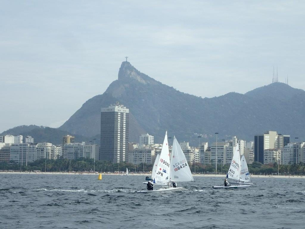 Aimi Tsuchii of the Japan sailing team practicing at the Baia de Guanabara, the location of the medal race in Rio de Janeiro. She is in the boat marked JPN. Photograph provided by the Japan Sailing Team.